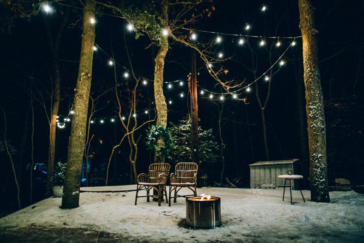 string lights deck night snow solo fire bonfire